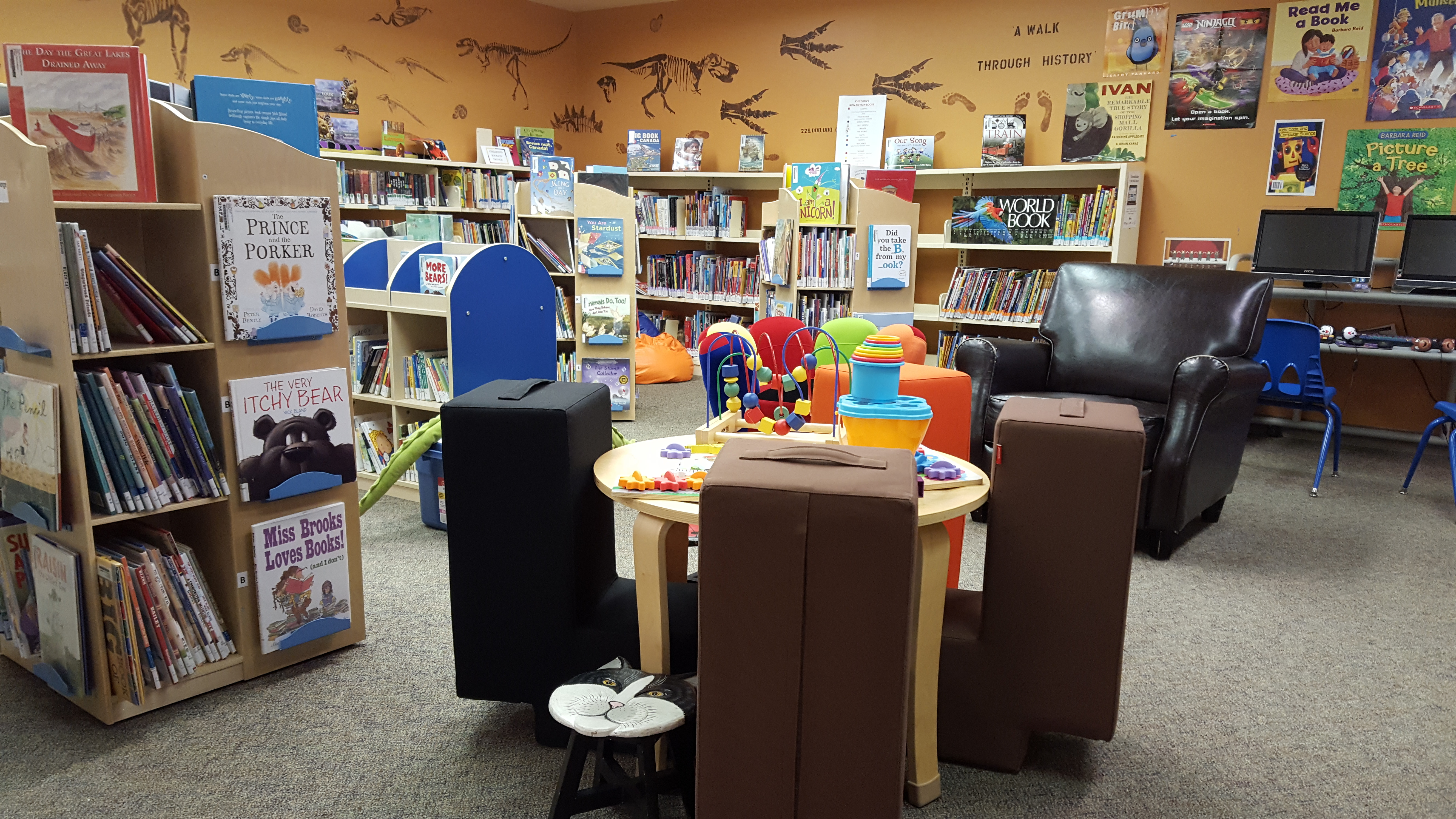 books on shelves, chairs and seating